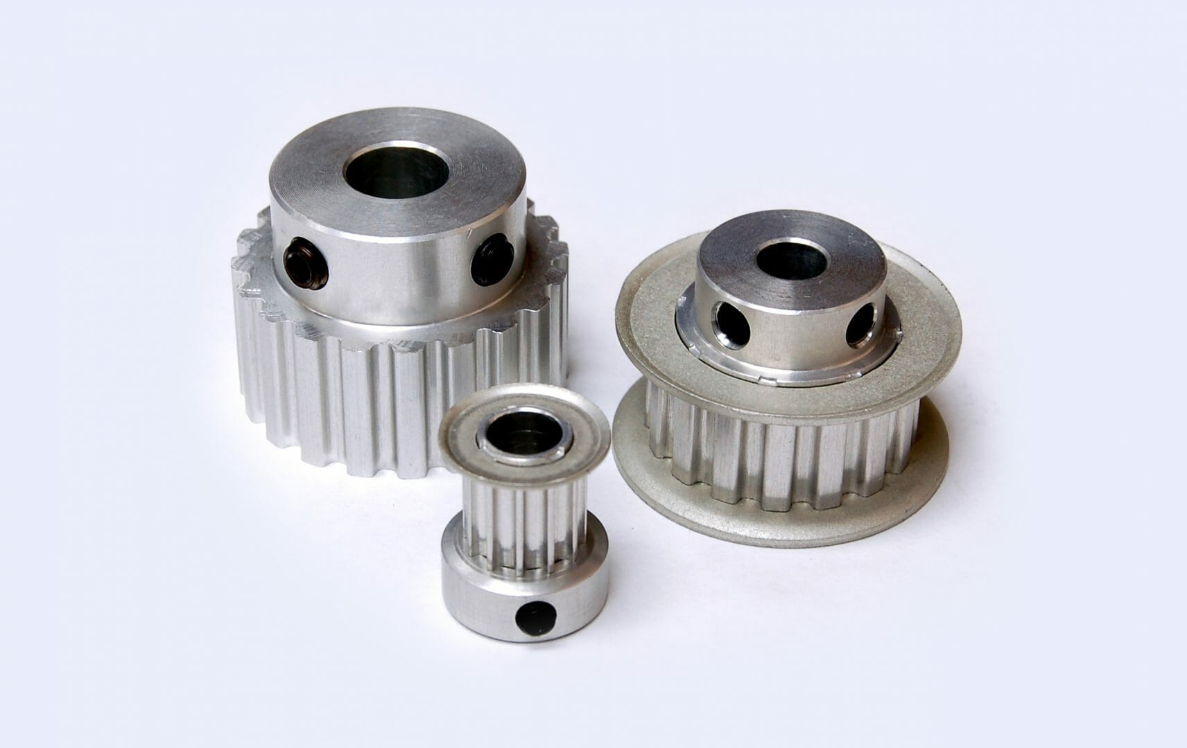 Three sizes timing pulleys small with flanges no flanges