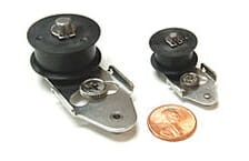 2 steel tensioners with black pulleys penny for size