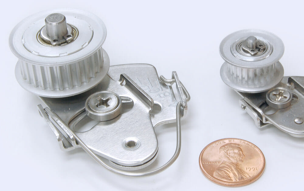 Dynamic tensioner with penny for size